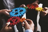 Business Team Connect Pieces Of Gears. Teamwork, Partnership And Integration Concept poster