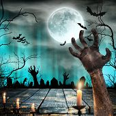 Spooky Halloween background with old trees silhouettes and zombie hand. poster