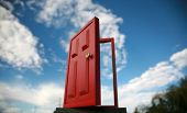 stock photo of dimentional  - a magic red door  leading to the outside world or perhaps a portal to the 5th dimention - JPG
