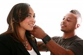 A african american professional cosmetologist brushes a beautiful models hair for a Beauty / Fashion