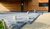 Laying Gray Concrete Paving Slabs In House Courtyard Driveway Patio. poster