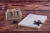Halloween Date On Wooden Cubes Calendar Staying On Table Near Blank Paper Notepad, Toy Spider And Sc poster