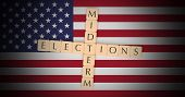 Us Politics News Concept: Letter Tiles Midterm Elections On Usa Flag, 3d Illustration poster
