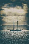 Old Wooden Ship In The Sea Under A Dramatic Sky.fine Art Image Canvas Texture Added. poster