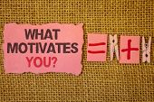 Handwriting Text Writing What Motivates You Question. Concept Meaning Passion Drive Incentive Dream  poster