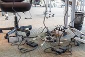 Concept Of Clutter In Office. Unwound And Tangled Electrical Wires Under The Table. 5s System Of Lea poster