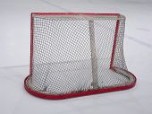 stock photo of bandy stick  - Empty hockey net on ice - JPG