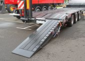 Heavy Equipment Transport Flat Bed Trailer With Loading Ramp poster