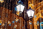 Street Lights And Christmas Decoration To New Year And Holidays. Festive Background. Illumination An poster