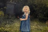 Happy Cheerful Child Girl Smiling Under Rain Countryside Concept Happy Carefree Childhood In Country poster
