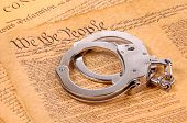 pic of bill-of-rights  - bill of rights and hand cuffs - JPG