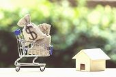 Home Loan, Mortgages, Debt, Savings Money For Home Buying Concept : Us Dollar Money Bag In Shopping  poster