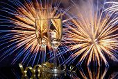 image of champagne glasses  - Glasses with champagne against fireworks - JPG