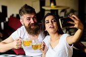Couple In Love On Date Drinks Beer. Couple Cheerful Mood Drinking Beer In Pub. Take Selfie Photo To  poster