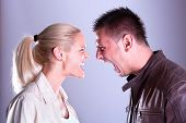 picture of strangling  - Woman and man yelling at each other - JPG