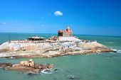 stock photo of swami  - Small island with Swami Vivekananda memorial - JPG