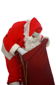 image of santa claus hat  - Santa looking in his magic bag of presents  isolated on white  room for text - JPG
