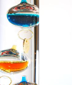 image of galileo-thermometer  - Based on a thermoscope invented by Galileo Galilei in the early 1600s this thermometer is called a Galileo thermometer - JPG