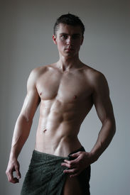 image of fitness man body  - Wat sexy muscular man wrapping a towel after shower - JPG