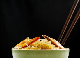 stock photo of pancit  - Pansit Bihon a Filipino noodle dish on black background - JPG