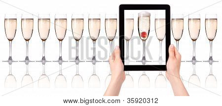 Glass Of Champagne On Tablet Computer Screen