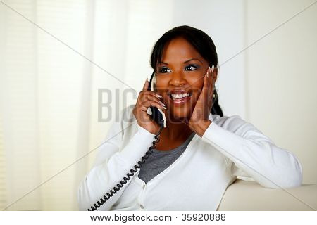 Surprised Female Smiling And Conversing On Phone