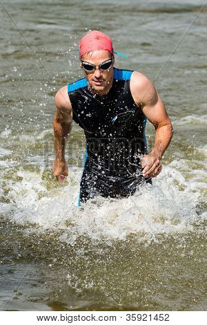 triathlete comming out of the water