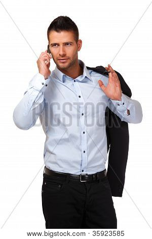 Serious Businessman Making A Call