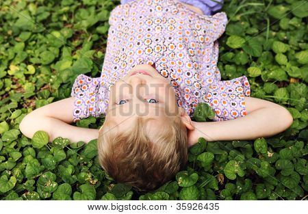 Little Boy Lying In Grass