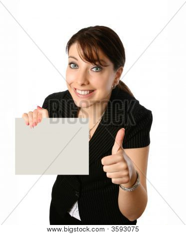 Beautiful Businesswoman With Thumb Up Sign Holding A Blank Card
