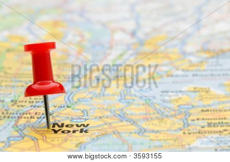 Red Pushpin Marking New York City On A Map, Selective Focus