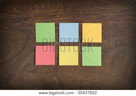 Sticky Notes On Wooden Background