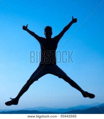 silhouette of young man who jumps