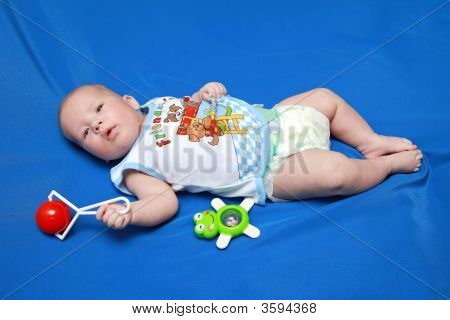 The Baby Of 3,5 Months With A Rattle