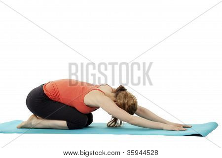 exercising fitness woman on a blue mat