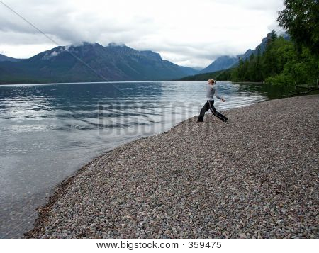 Woman Skipping Stones
