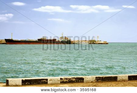 Large Transport Ship Is Far From The Pier