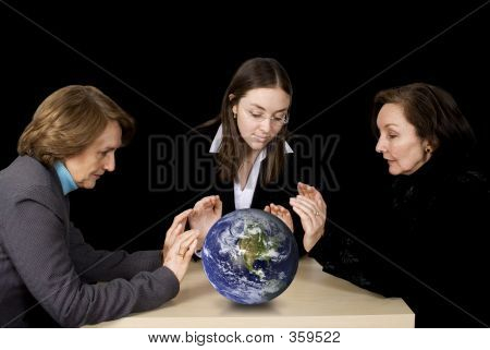 Business Team With Globe Over Black