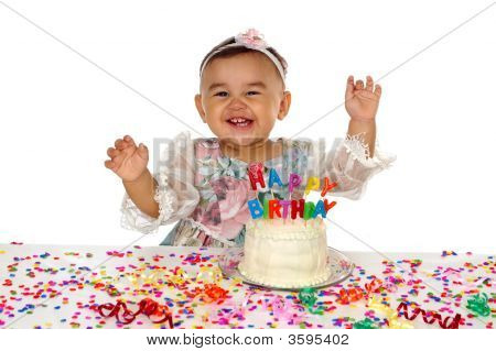 Hispanic Girl And Birthday Cake