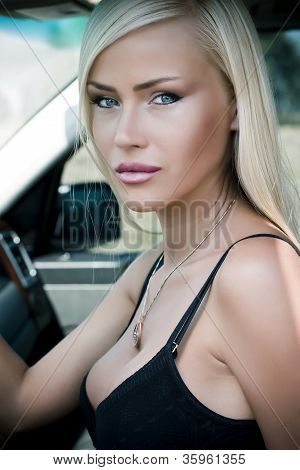 Portrait Of A Sexy Woman In  Car