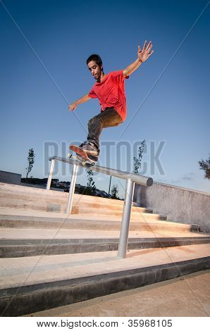 Skateboarder On Rail