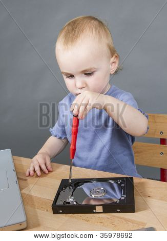Young Child Working At Open Hard Drive
