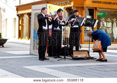 Concert In The Street Of Violinists
