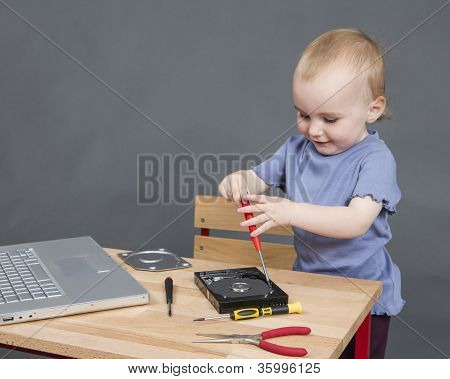 Child Working At Open Hard Drive