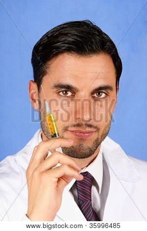 Doctor Holding Syringe
