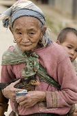 Asia, Old Woman With Chicken And Grandson poster