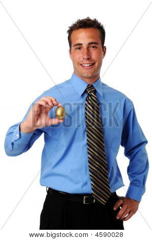 Man Holding Golden Egg