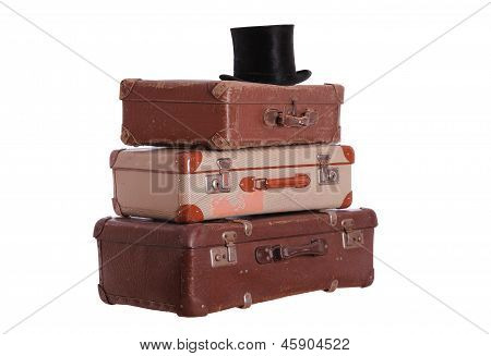 Old Hat On Top Of Stacked Suitcases