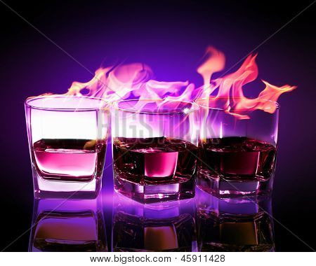 Image of three glasses of burning puple absinthe