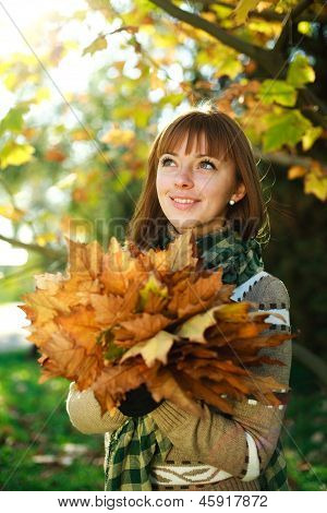 Outdoors Closeup Portrait Of Autumn Girl With Leaves